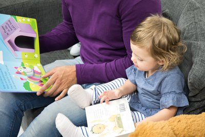 dad and baby share a book